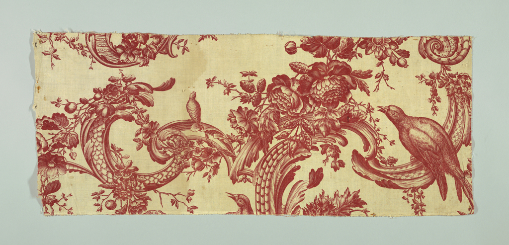 Fragments of a large scale patterns of birds and scrolls. In red on white.