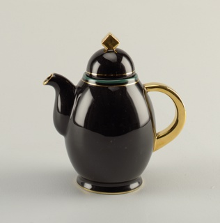 Tall footed coffeepot in black, curved and bulbous spout; foot rimed in gold, handle in gold; mouth rimmed in turquoise and gold. Lid is hemispherical in black with cube in gold as finial.