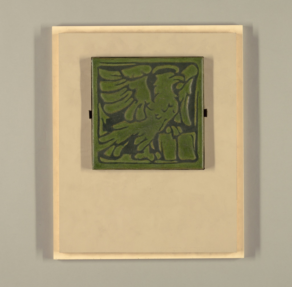 Green griffins holding book