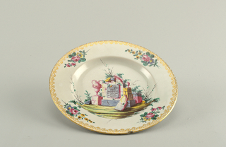 Plate with floral bouquets on marly and gilded rim. At center, ruins in a landscape.