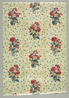 Large multi-colored floral sprays on a background decorated with forget-me-nots.