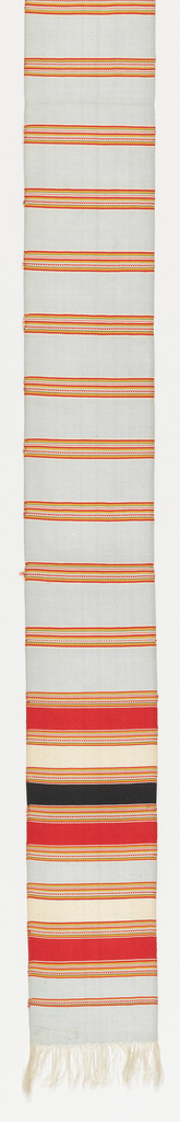 Narrow sash or belt of vertically ribbed silk plain weave. Pale blue ground with fine horizontal stripes of red, yellow, green, black, and white. Ends striped more broadly in same colors. Ends have short fringe formed by warp ends.