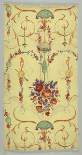Polychrome block print on yellow linen. Elongated symmetrical classical motif. Green ewer containing red roses with purple leaves. Over flowers is a white canopy, from either side are suspended purple garlands of red flowers, cymbal and horns. From handles of ewer are swags of red and white flowers on purple vine. Ewer stands on green oval plaque with cherubs and connected to yellow tassel? from which hang another green plaque with cherubs and reclining female figure. On either side are elaborate yellow and red scrolls holding smoking green torches.