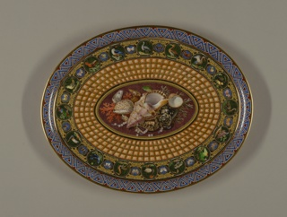 Oval tray with raised and everted rim.  Decorated with outer border of interlaced triangular geometric motifs in lapis blue against brown background, surrounded by thin gold rims; then a border of tooled gilding with 16 roundels painted in polychrome of exotic birds, alternating with the smaller roundels with butterflies.  Around central oval a wide band of trompe-l'oeil coffering.  Center painted with arrangement of seashells, coral, and pearls against a faux marble background.