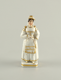 A woman dressed in white with gold accents. She wears a fringed apron and carried a gold watch (?)