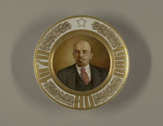 "Circular; with finely painted portrait of Lenin in center; around the border, between gilded bands, leaves, and star, the inscription ""1870/1980/110"""