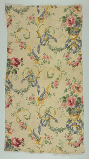 Polychrome block print on natural linen, printed to resemble very coarse linen. Off-set rows of yellow urns, wrapped with blue ribbon containing pink roses, blue, yellow and pink flowers. Between rows of urns are scrolling yellow vines with roses on blue ribbons.