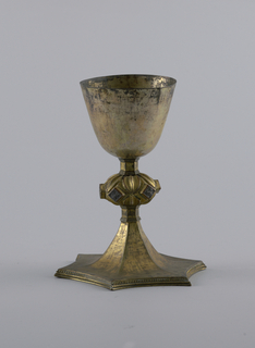 Cup rests on star-shaped foot. Stem composed of bulbous section with framed rhomboids, and bell-shaped cup with thin flaring sides.