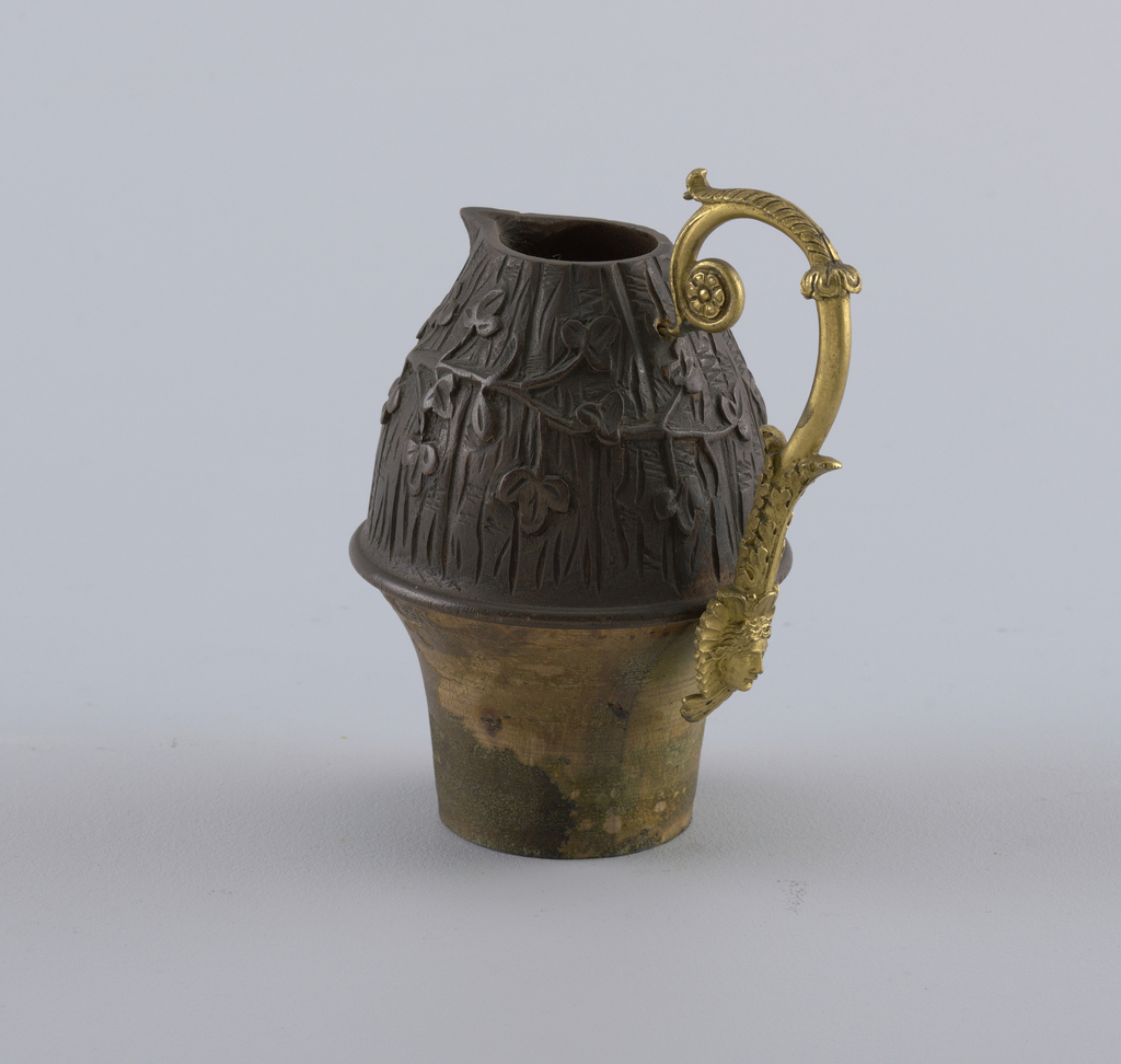Jug with loop handle decorated with mascaron and acanthus volute.