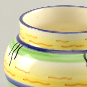 Round vase with short neck and no lip. Horizontal stripes in blue, green and yellow, with short hand painted orange and blue lines.