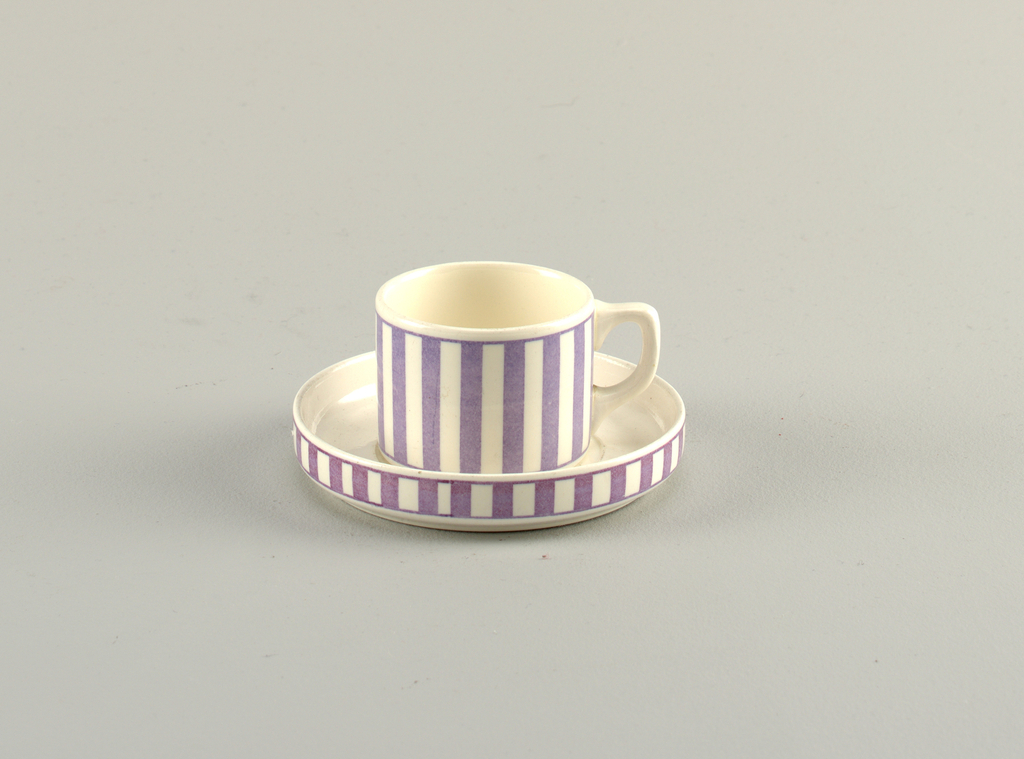 Straight-sided cup and saucer, both with vertical purple stripes on white ground.