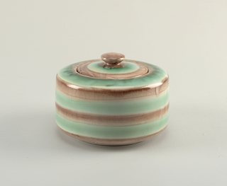 Short round box and small flat lid with knob. Brown and green striped glaze.