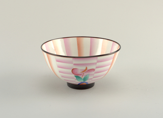 Bowl decorated with large stylized flowers on a background of peach and white vertical and horizontal stripes.