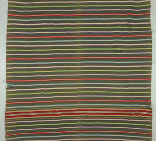 Black sarape with repeating series of stripes in red, blue-violet, green and purple. Sequence of stripes broken at either end for a band of yellow, red and white stripes. Remains of warp fringe on ends.