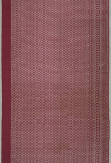 Sarong (or skirt) with border of floral diamond stripes on one side (bottom of skirt) and an unpatterned red band at the other (top of skirt). Separated by a field showing an all-over floral diamond pattern in ivory (weft) and red (foundation).