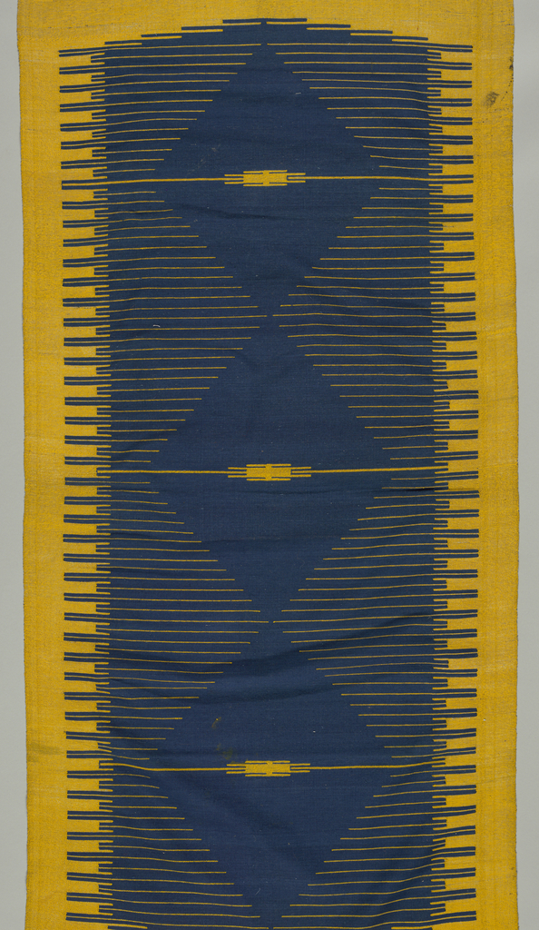 Blue ground with four groups of four yellow and metallic weft bands at either side of a central motif showing three blue diamonds set in yellow and metallic thread.