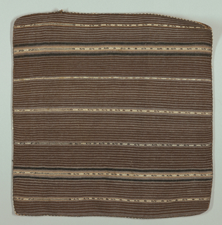 Contained square with thin stripes in two shades of brown with broader stripes at intervals in tans, black, white with narrow geometrically patterned central stripe. Edged on four sides with fancy buttonhole stitch in black, tan, and white wool.