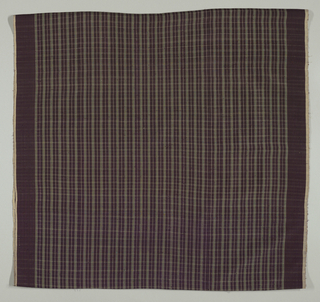 Textile sewn into tube to make skirt. Shows small-scale green and white plaid on purple ground.
