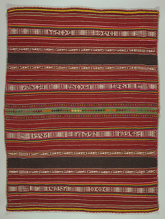 Square made of two lengths seamed down long side. Edged on four sides with patterned tubular embroidery. Broad stripes of red and dark brown with thin stripes in white, pink, yellow, and green. Intervals of warp-patterned stripes in these colors and white showing humans, animals, geometric forms, high pointed scrolls. Seamed down center with loose stitch in bright wools forming strip of triangles.