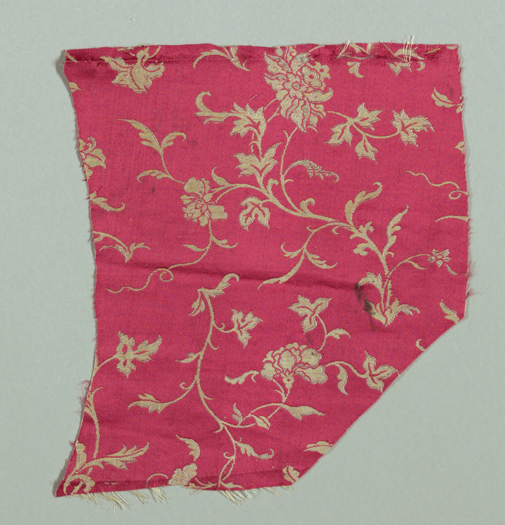 Floral sprays in white on cerise background.