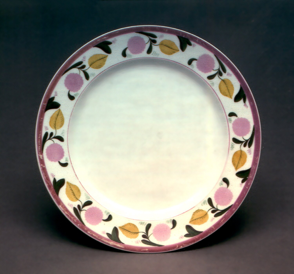 Circular, painted around border with vine consisting of yellow leaves and pink blossoms