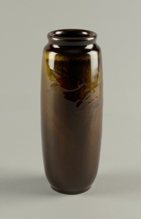Tall cylindrical vessel curving in at base to slightly undercut foot and curving in at top to indentation marking off thick, roundest, out-curving lip of wide mouth. Tiger-eye glaze [browns with iridescent gold streakings]. Bird and wave painted under glaze.