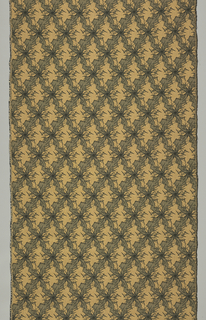 Golden yellow textured fabric with angular shapes in black and grey.