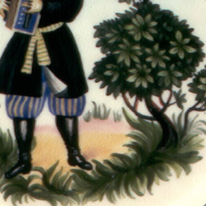 Circular, with wide blue border; in the center a man dressed in Russian peasant costume playing accordion, tree, grass, flowers