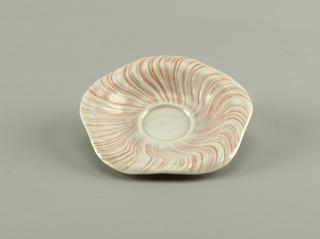 Shell motif saucer.