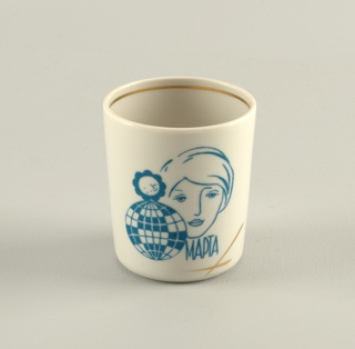 """Cylindrical, with image of woman's face, an 8 made up of a globe and a flower, and the inscription """"March."""""""