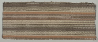 Sample width of handwoven fabric in horizontal stripes in shades of brown, rust, tan, and white.