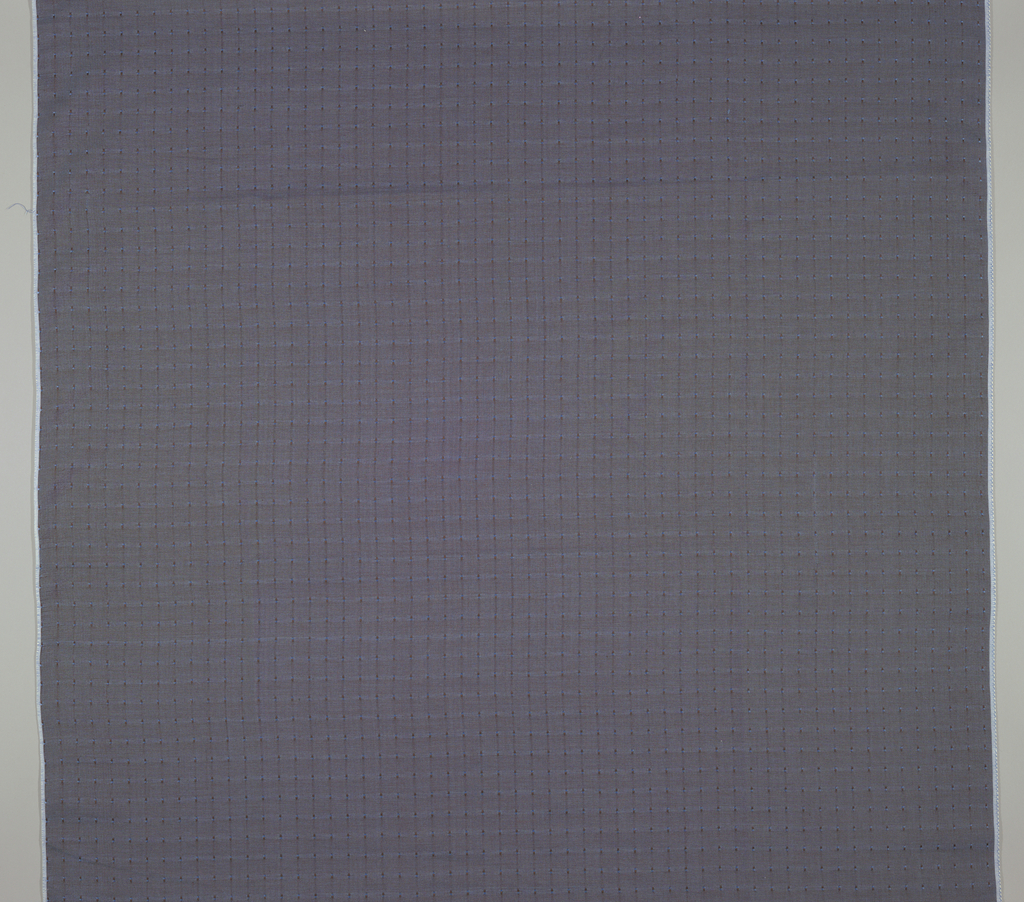 Plain weave with dark brown warp and blue weft.  Small dot pattern of warp and weft  floats.