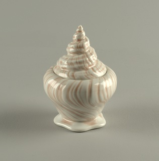 Conch shell-shaped sugar bowl with lid.