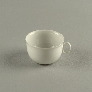 Wide-mouthed, slight flared cup, thin porcelain, base of cup has an indented point; handle is curled with both ends attached to side.