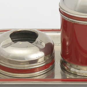 Smoker's set consisting of cigarette holder, two ashtrays, and a tray
