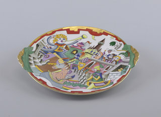 Plate depicts crowded, overlapping scene with abstract figures and buildings; two gilt scalloped handles and gilt rim. Some figures are singing, and watching armed men on horseback, blonde figure blowing trumpet; castle and bell tower in background.