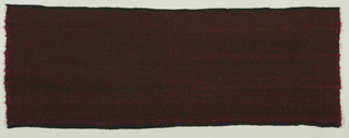 Firm coarse cloth with heavy red wefts and black warps, giving a changeable effect.