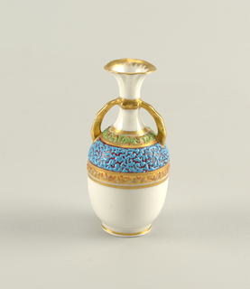 Small ovoid vase with circular base, slender neck with outcurved lip, and two quadrant handles attached to shoulder of neck.  Banded decoration about shoulder of gilding and color, encrusted with random pattern of fused particles of glass in various colors.  Gilding on base, handles and lip.