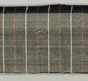 Cloth with white weft and black warp, pencil-striped alternately in white and rust at fairly wide intervals.