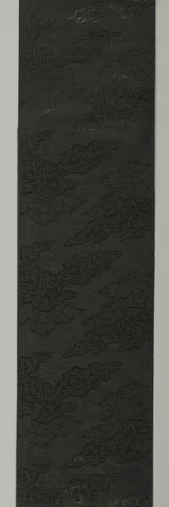 Length made for a black mourning kimono showing abstract pattern formed by plastic inserts.