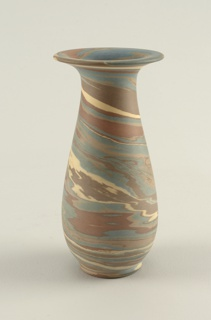 Vase with curved, pear-shaped profile and broad flaring lip.  Body of brown, beige, blue and white mottled and wedged stoneware to create overall marbled effect.  Unglazed.