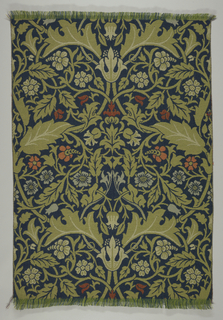 """Length of so-called """"Kidderminster"""" or ingrain carpeting with a single repeat of a large-scale symmetrical pattern. An ogival framework with acanthus leaves, twining stems and flowers in shades of green with pale blue and brick red on a dark blue ground.  Two narrow plain weave selvages."""