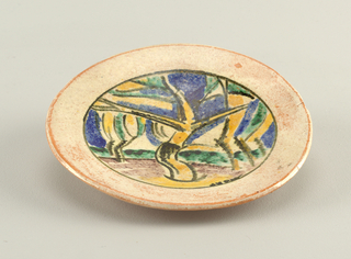 Circular plate decorated with abstract landscape of trees on low hill, in palette of yellow, green, blue, purple, white and black; wide rim glazed in mottled white.