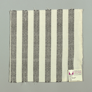 White plain weave with vertical black stripes. Black striped patterning is formed by narrow bands of supplementary warp floats.