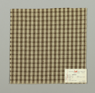 Plain weave checked pattern in brown, beige and white.