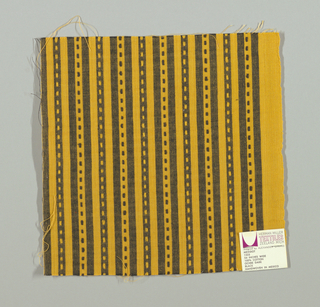 Gold and black narrow vertical stripes with small gold and black rectangles. Rectangular patterning is formed by supplementary warp floats.