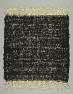 Hand-woven rug sample with black and white textured surface.