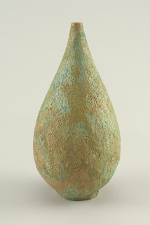 Teardrop-shaped bottle with textured brown, blue, and green glazed surface.
