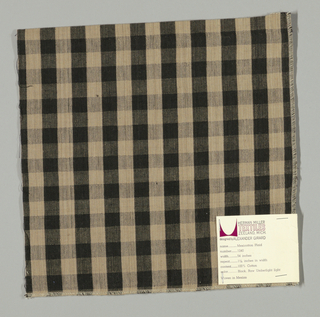 Plain weave, slighly warp-faced gingham pattern in beige and black.