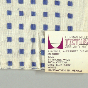 White plain weave with blue squares. Square patterning is formed by supplementary warp floats.